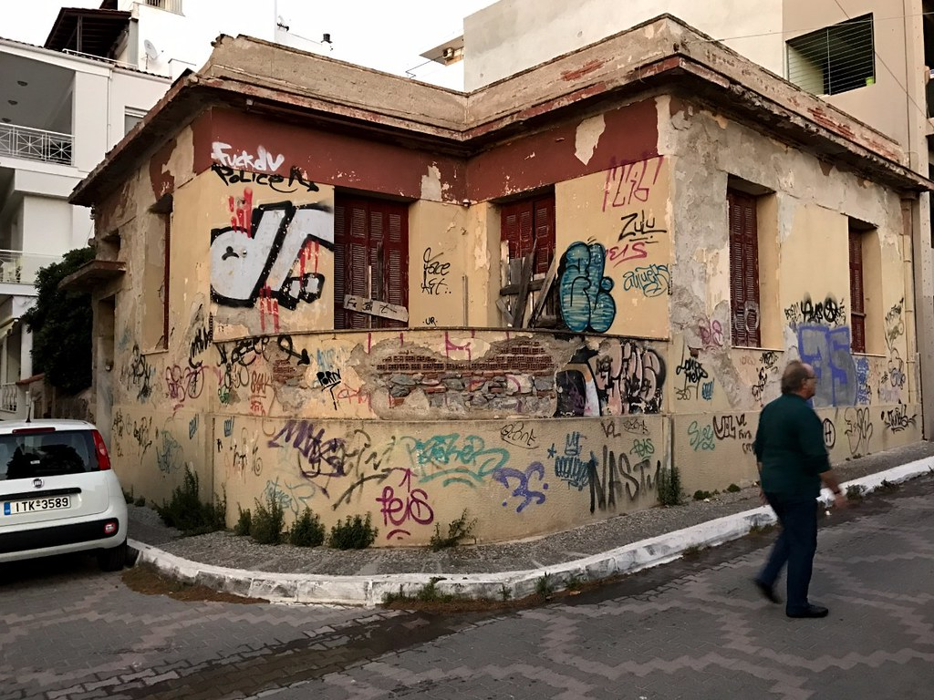 abandoned corner house in athens