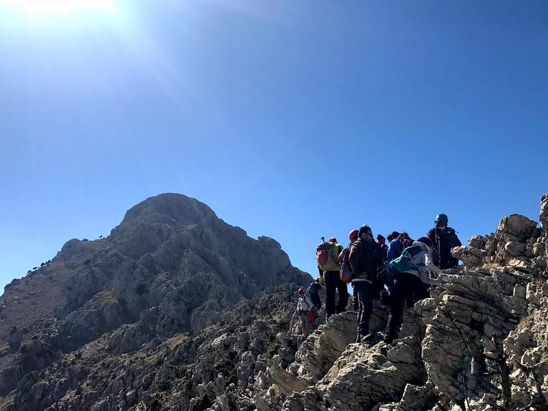 crossing narrow mountain ridge to the summit of artemision mountain in peloponnese
