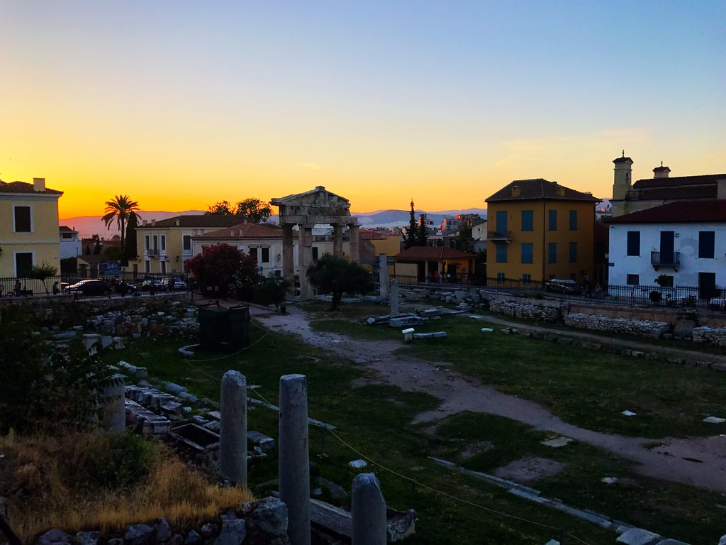 beautiful sunset over ancient ruins in athens