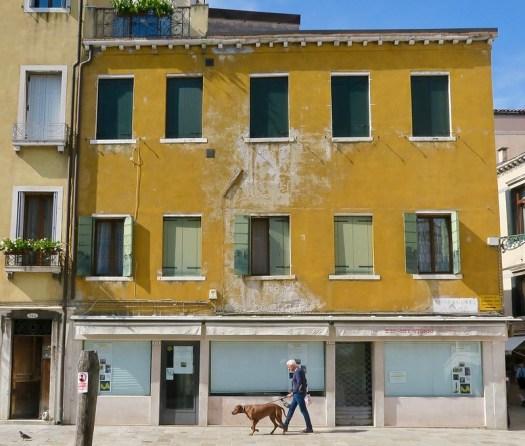 Man w Dog on Mustard Yellow House
