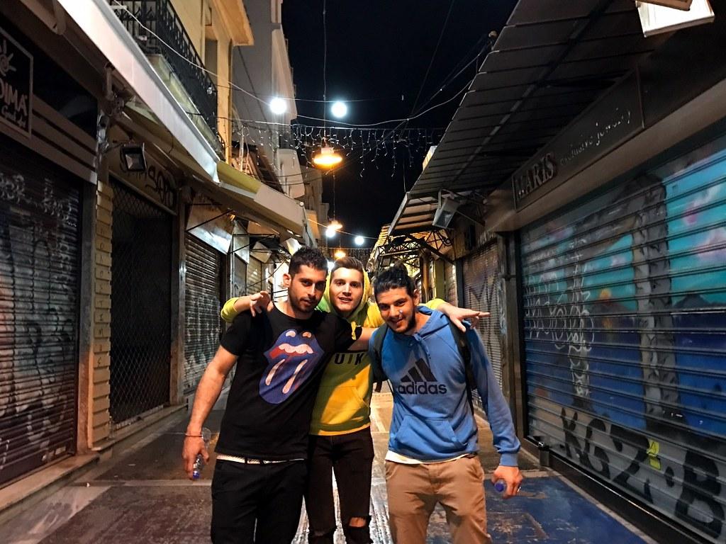greeks in monastiraki market street in the night