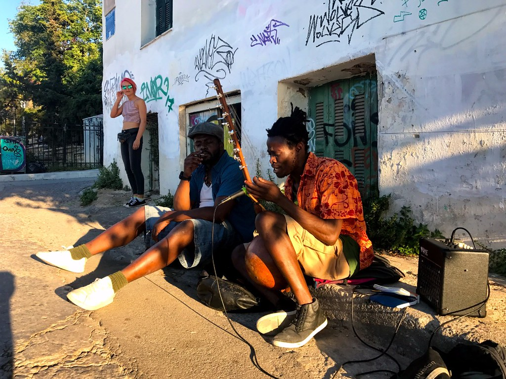 african men busking in the streets of athens