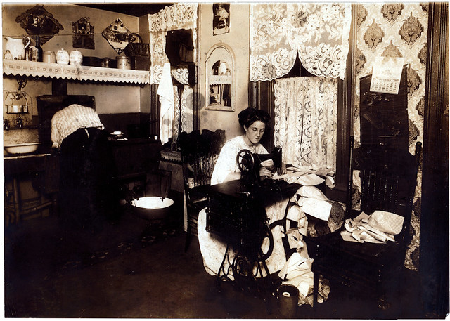 Already desperately ill with tuberculosis, Annie Maier was photographed sewing doll clothes in her family's New York basement apartment in 1911