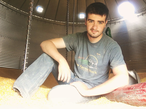 Ryan Kuster inside the grain bin auger