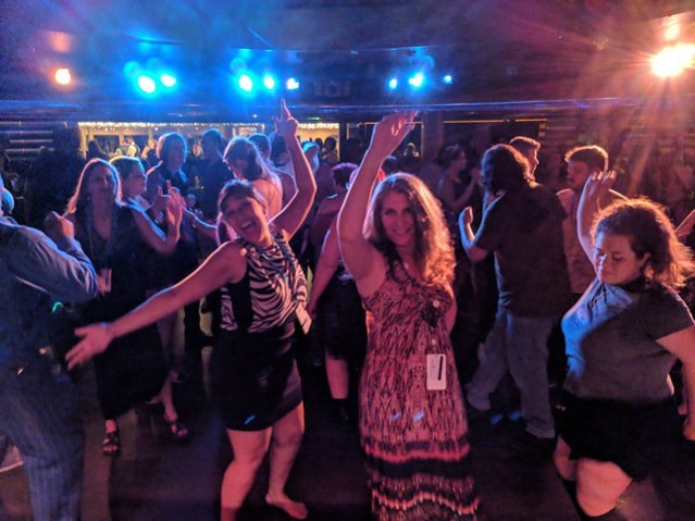 A picture of the dancers at the JoCo Cruise 80s Dance, including one Kristine Scalzi