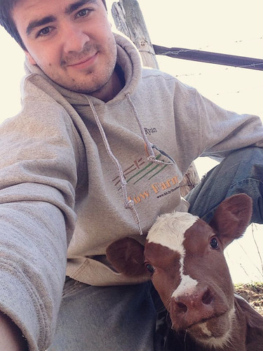 Ryan Kuster with a calf