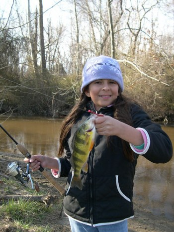Photo of happy girl with yellow perch