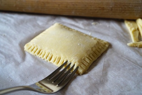 Homemade gluten free pop tarts | crimping the edges with a fork