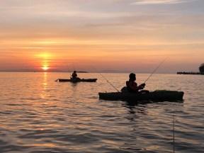 Photo of Kayak fishing at sunset