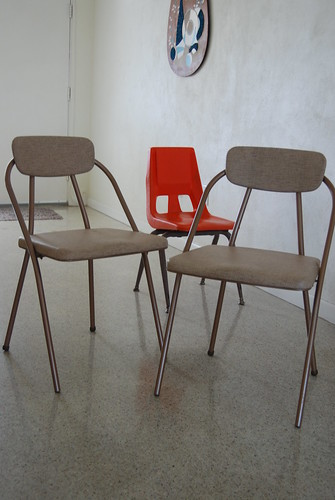 vintage costco fold out chairs and a kids molded plastic c