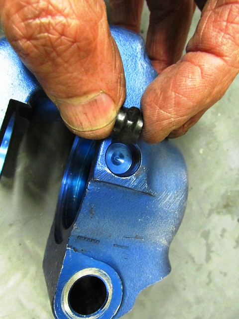 Button Removed From Hole in Caliper