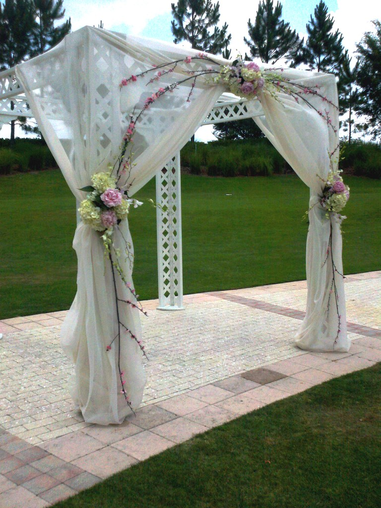 wedding arbor  Pink peonies with white hydrangea and silk