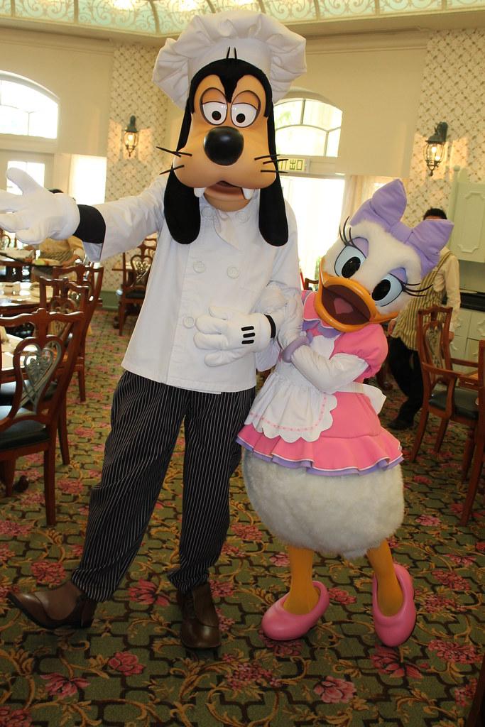 Chef Goofy and Chef Daisy say goodbye at the Enchanted Ga