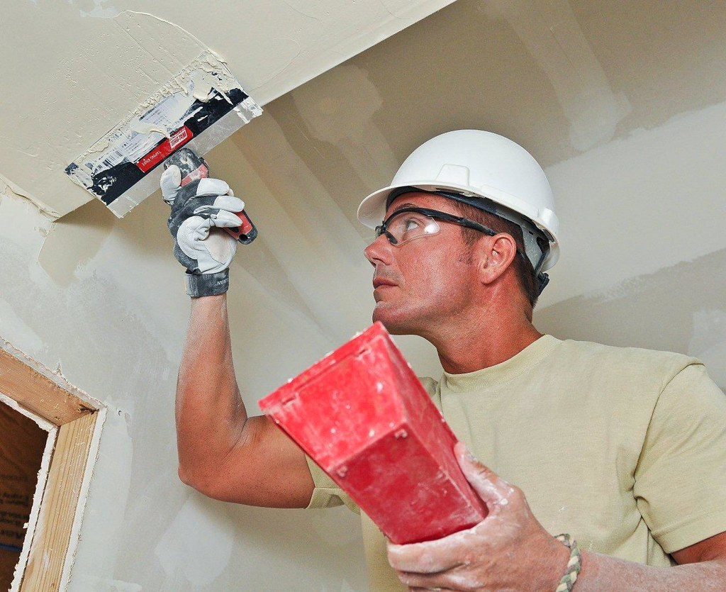 Applying drywall joint compound  Tech Sgt Russell Hunt of  Flickr