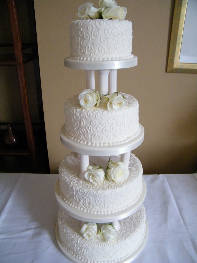 4 tier wedding cake with pillars  Michelle  Flickr