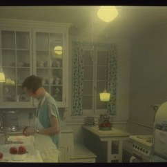 Light For Kitchen Swinging Doors Residential Woman In Kitchen, Circa 1930s | Item 78065, City ...