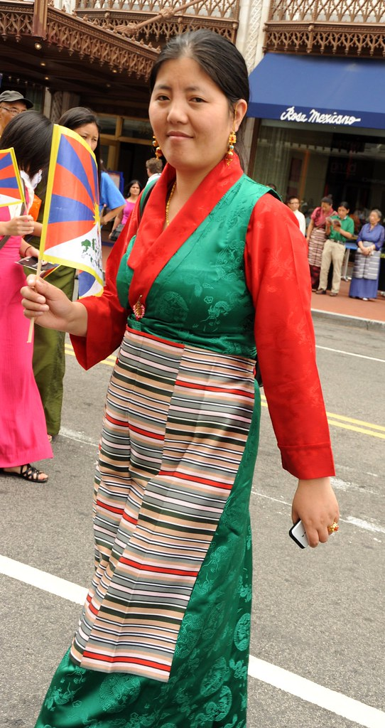 Sweet Faced Tibetan Woman Wearing A Green Silk Chuba With