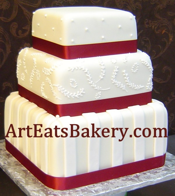 Three Tier Square Fondant Wedding Cake With Red Ribbons