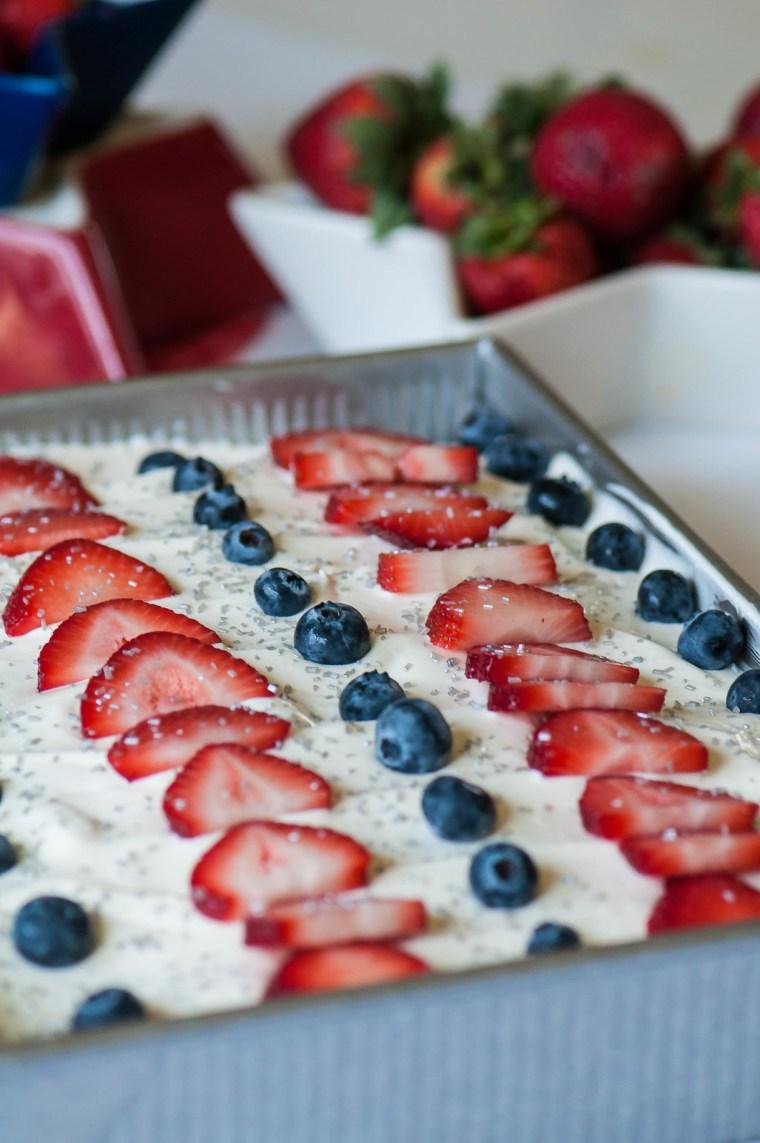 Keep things festive with this 4th of July Poke Cake. It's simple to prepare, starting with a cake mix, and will definitely steal the show.