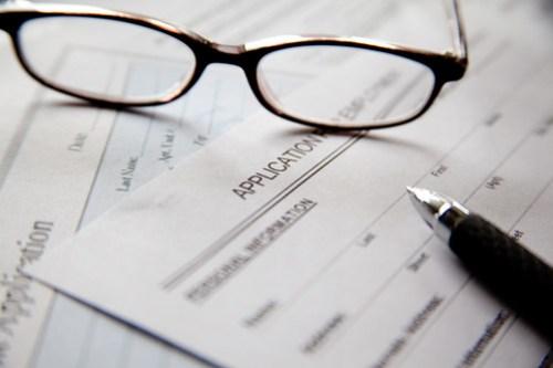 Glasses, pen, job application