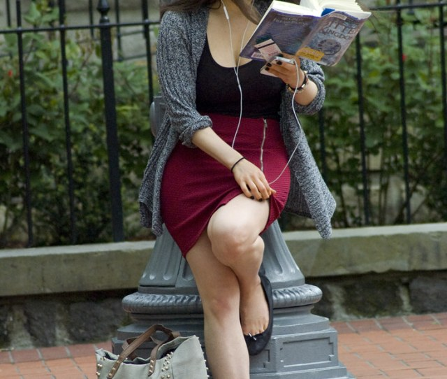 Beautiful Girl Reading A Library Book While Waiting For Public Transportation By Doyle Wesley Walls