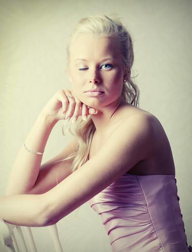 girl with one eye closed  Teenage blond scandinavian girl
