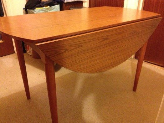 Image result for Round dinner table, folded sides