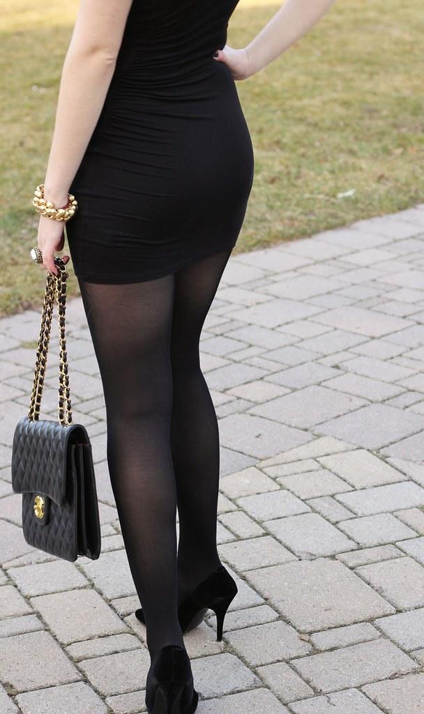 girl in litle black dress black tights and black high heel