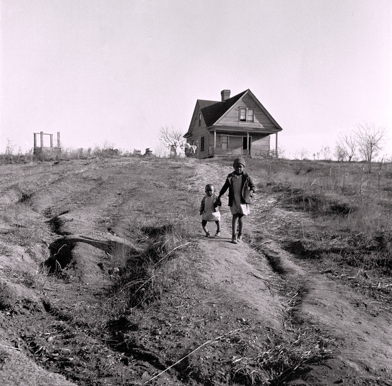Wolcott, Marion Post, photographer. Negro children and old home on badly eroded land near Wadesboro, North Carolina. Dec, 1938.
