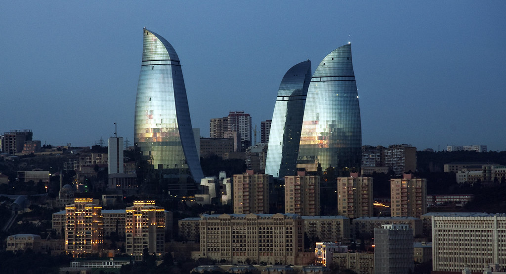 Flame Towers of Baku  The sunset in the Caspian sea is
