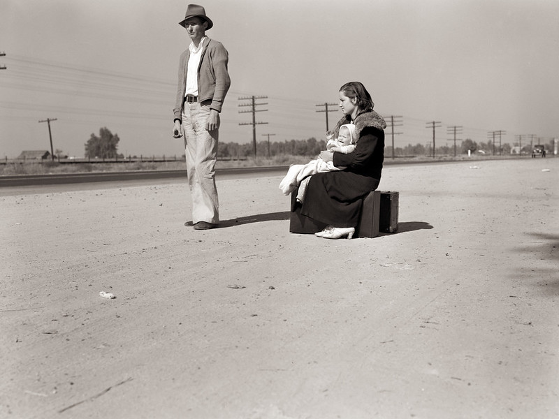 Lange, Dorothea, photographer. Young family, penniless, hitchhiking on U.S. Highway 99, California. The father, twenty-four, and the mother, seventeen, came from Winston-Salem, North Carolina, early in 1935. Their baby was born in the Imperial Valley, California, where they were working as field laborers. Nov, 1936.