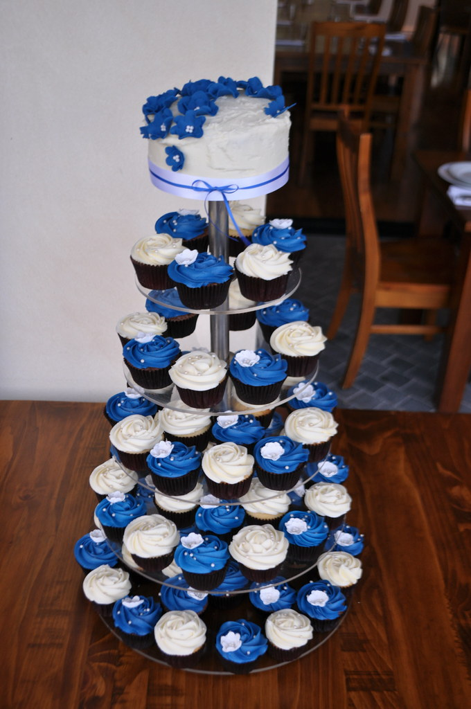 Royal blue and cream wedding cupcakes  Choc mud and white