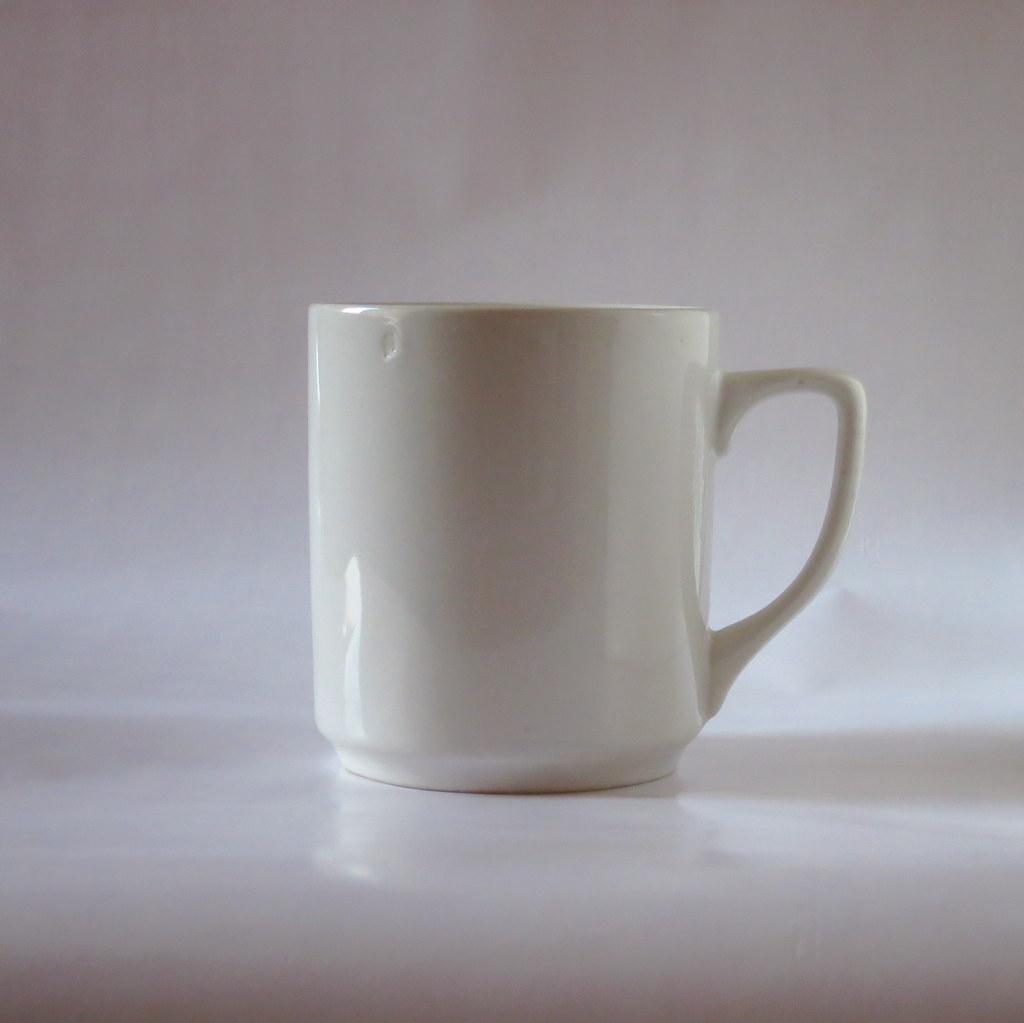 White mug  White mug against a white backdrop used for a