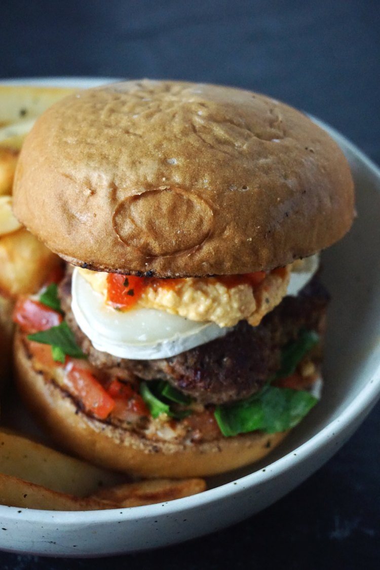 Gluten free Greek style lamb kofta burgers with goat cheese, hummus and a homemade salsa