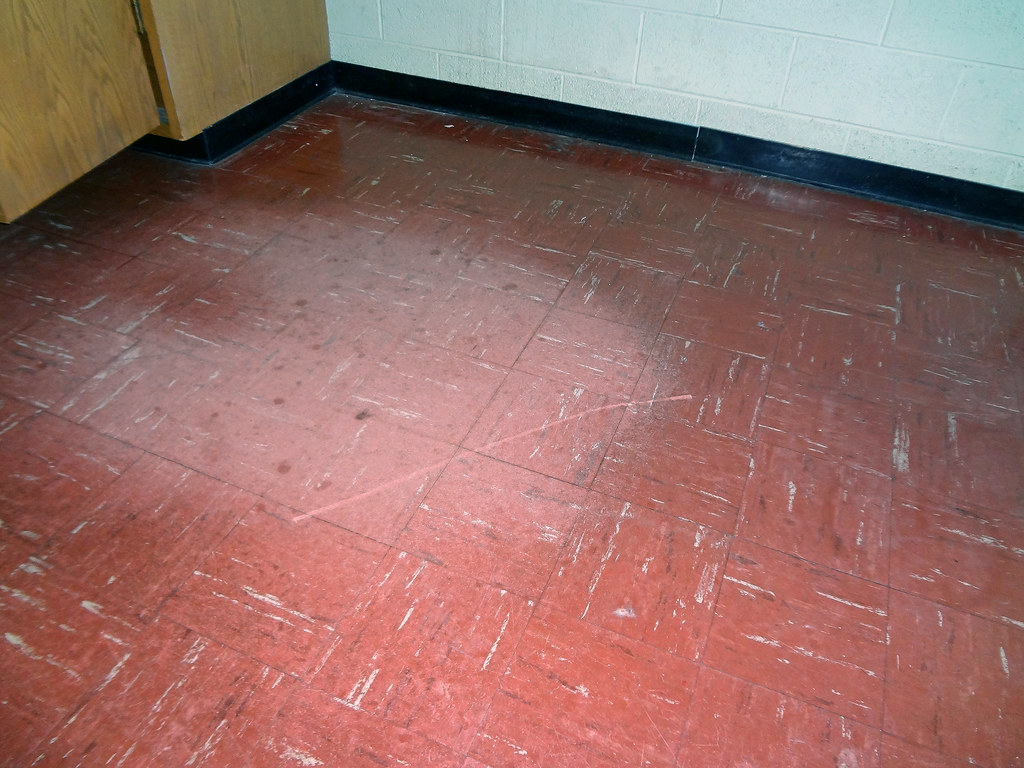 Asbestos Floor Tile Wear Damage  Example 4  An example