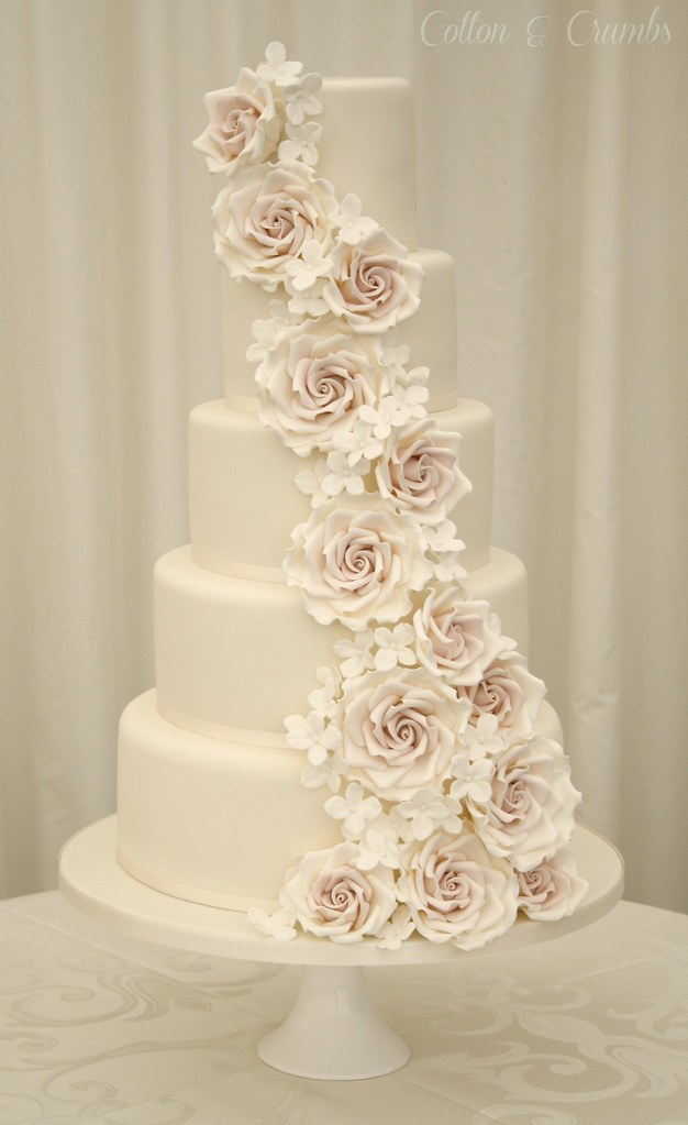 Rose cascade wedding cake  Set up in the marquee