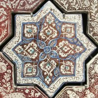Islamic tile, leaf design in brown, blue and white