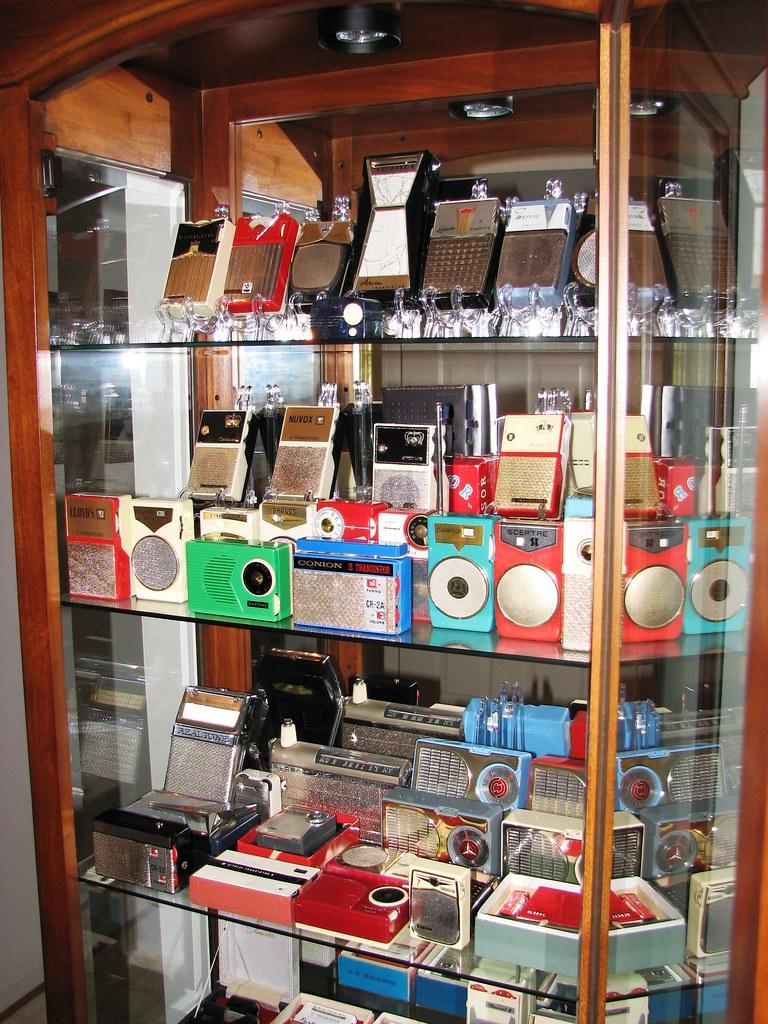 Vintage Transistor Radio Collection I  A cabinet holding