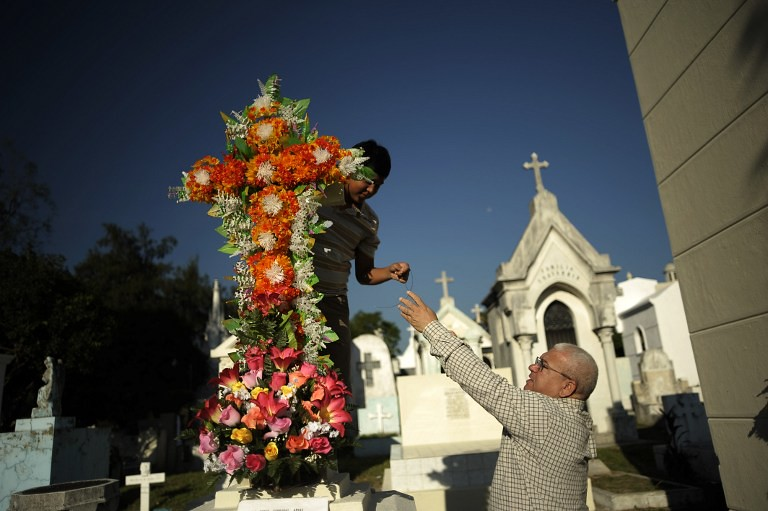 EL SALVADORRELIGIONALL SOULS DAY  People decorate the