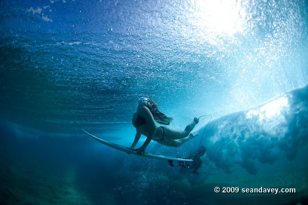 Surfer Girl Bali Wallpaper Under Water View Of Surfer Girl Ducking Under A Breaking W