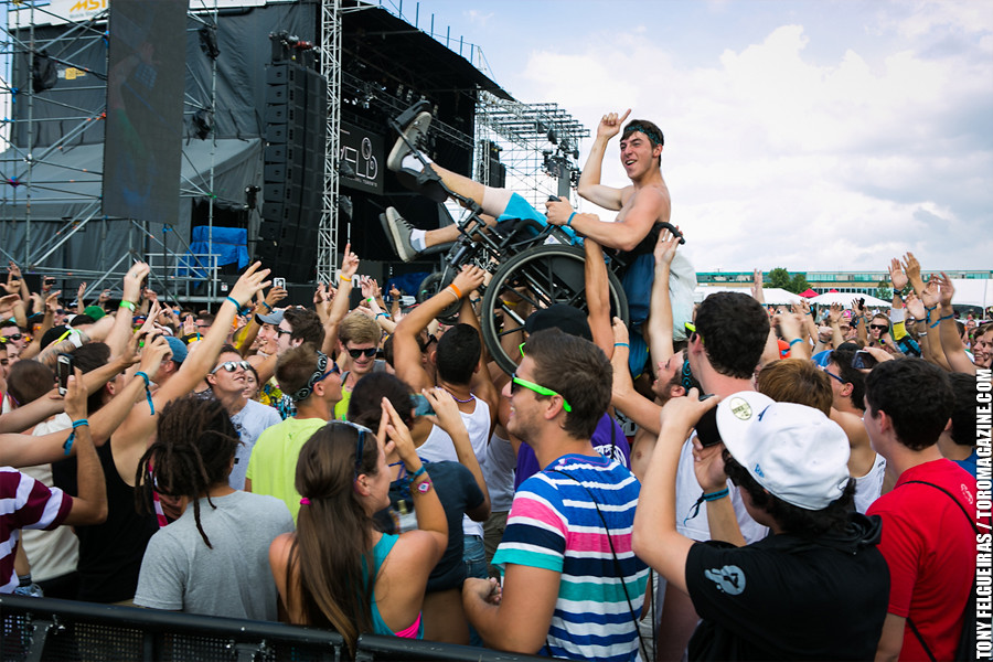 Wheelchair Crowd Surfing  A music fan crowd surfs in his