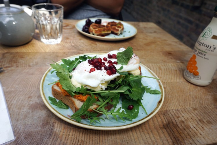 Poached eggs and grilled halloumi on gluten free sourdough toasts at Beyond Bread bakery (Beyond Bread Islington Branch)