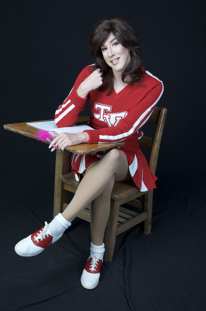 Cheerleader at her desk  Jamie Gibson  Flickr