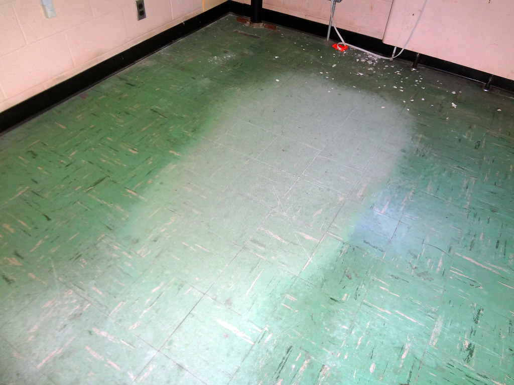 Asbestos Floor Tile Wear Damage  Example 3  An example