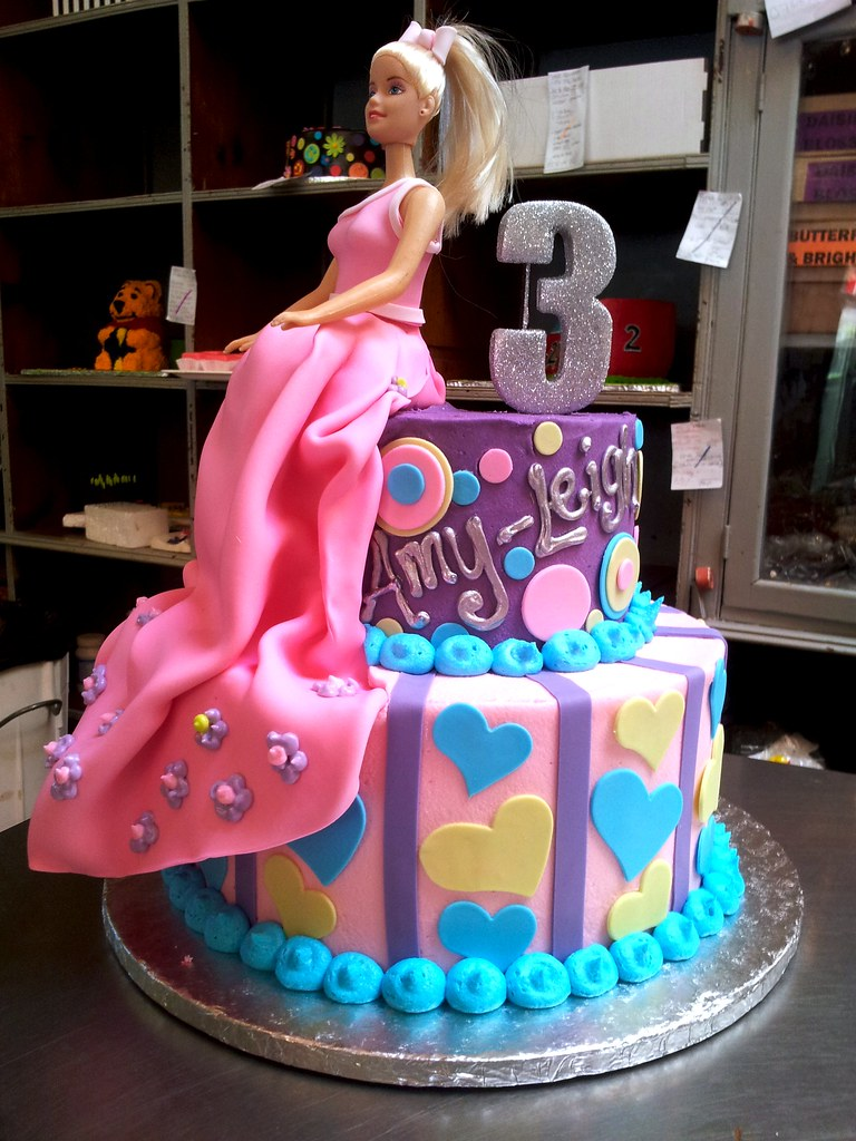2tier Wicked Chocolate cake iced in pastel butter icing d