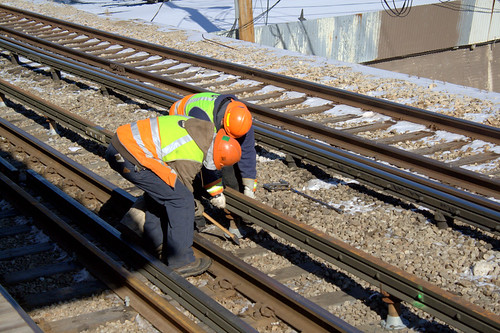 Third Rail Replacement  Workers wedge a third rail chair
