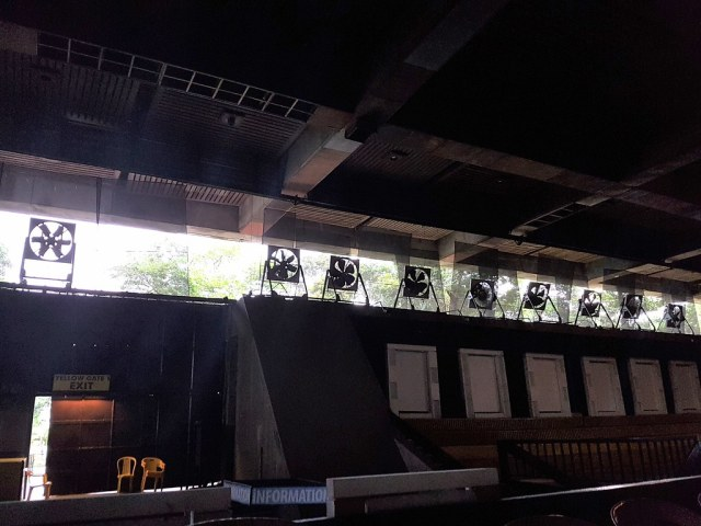 Fans placed at the open area of the theater to provide ventilation