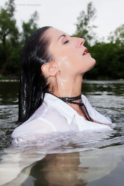 2 girls have some splashing fun in the lake  Get the full