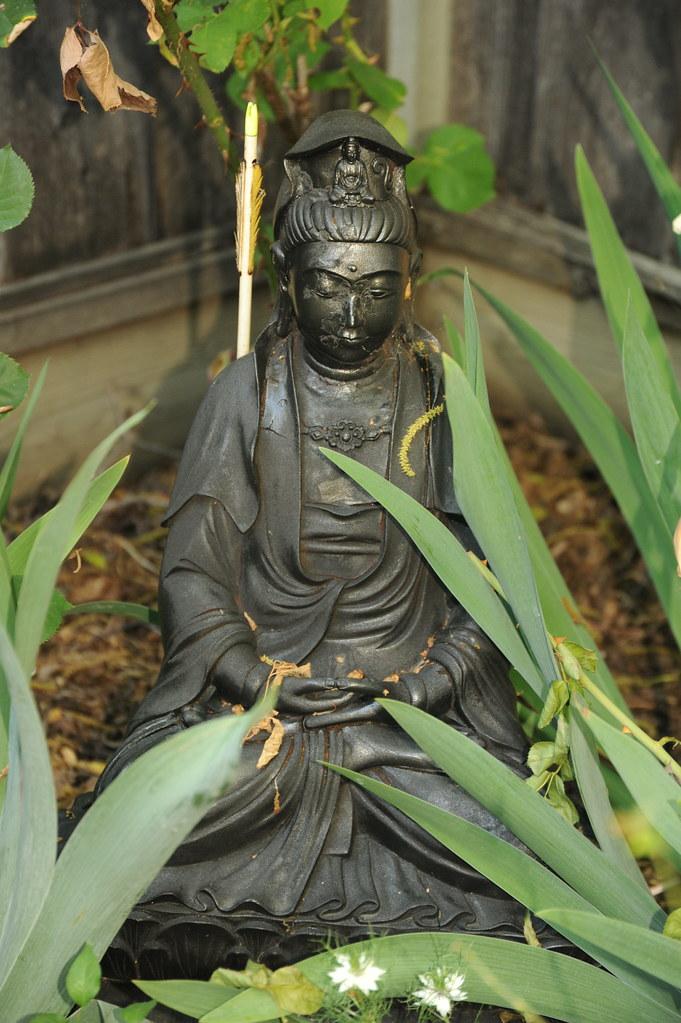 Black Quan Yin Bodhisattva with Avalokiteshvara on her cr
