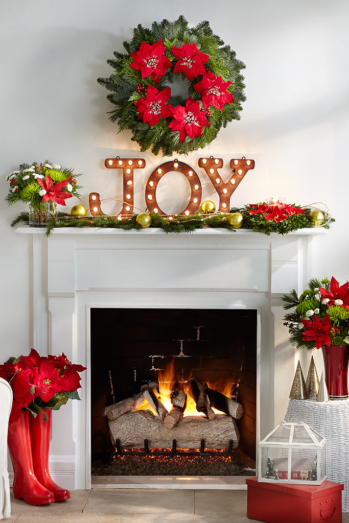 Merry mantel with lighted Joy sign pine cuttings with orna